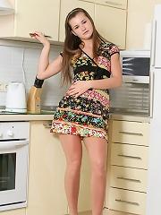 Innocent teen Bella strips nude in the kitchen