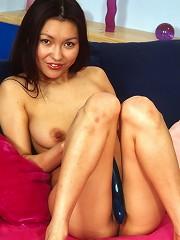 Teenage asian with a purple dildo